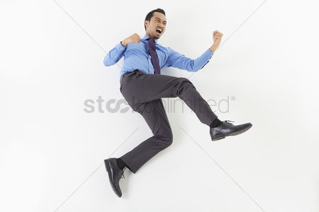 Fight : Businessman posing on the floor
