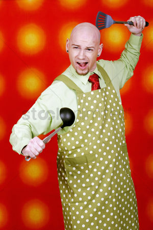 Funny : Businessman posing with kitchen utensils