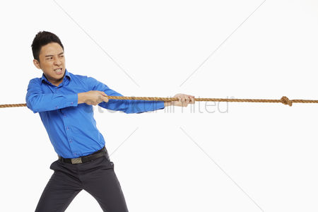 Rope : Businessman pulling a rope