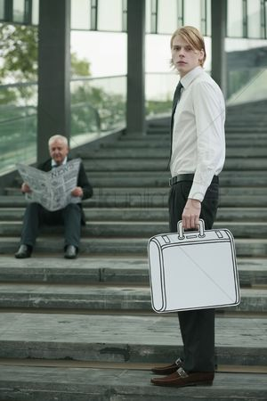 Cardboard cutout : Businessman reading newspaper on the stairs  another businessman carrying briefcase