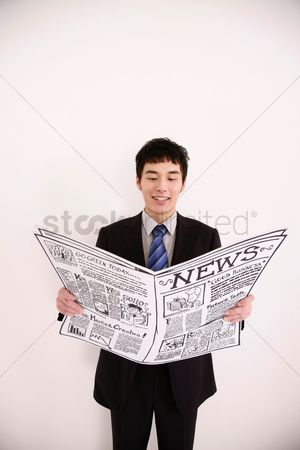 Cardboard cutout : Businessman reading newspaper