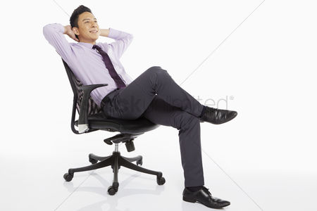 1847233 Relaxing In Chair Businessman On A