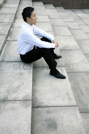 Staircase : Businessman sitting at the staircase
