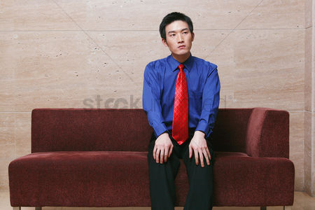 Wondering : Businessman sitting on couch