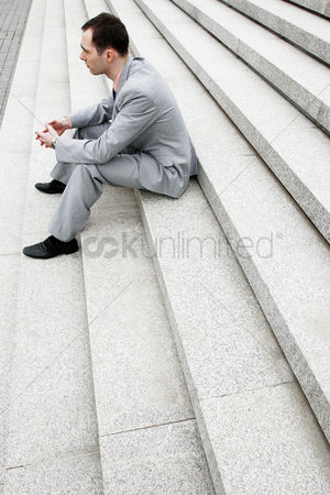 Stairs : Businessman sitting on the stairs thinking