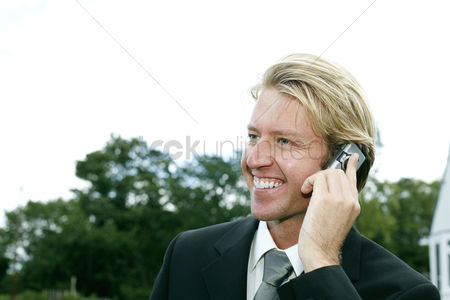 Cellular phone : Businessman smiling while talking on the phone