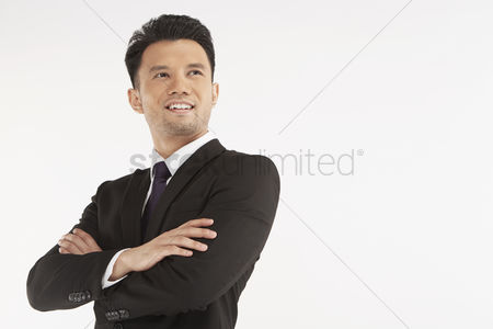Masculinity : Businessman smiling with arms crossed