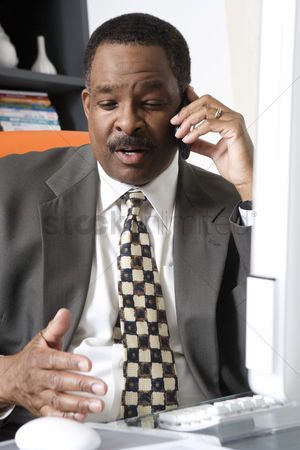Cellular phone : Businessman talking on cell phone