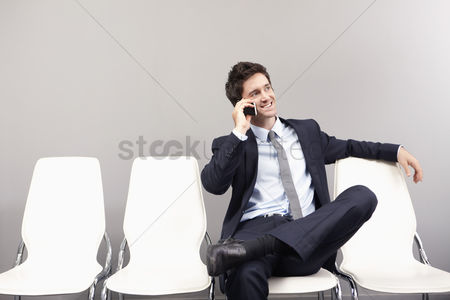 Individuality : Businessman talking on mobile phone