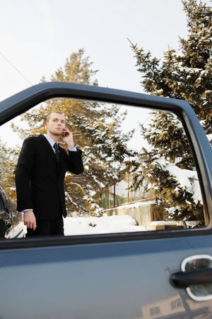 Cold temperature : Businessman talking on the phone