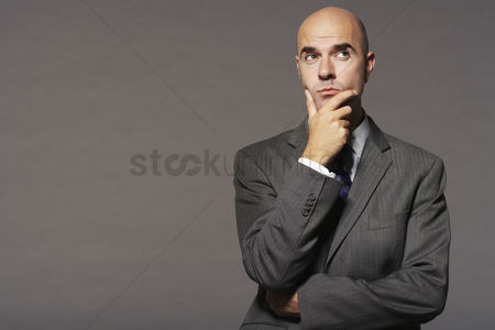 Head shot : Businessman thinking