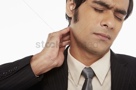 Masculinity : Businessman touching his neck