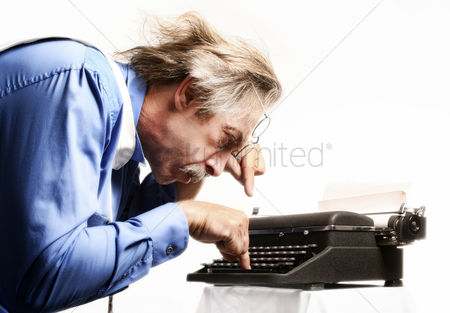 Mature : Businessman using a typewriter