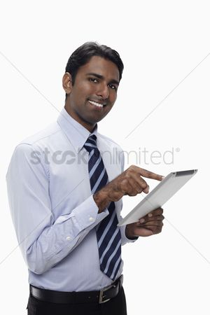 Portability : Businessman using digital tablet