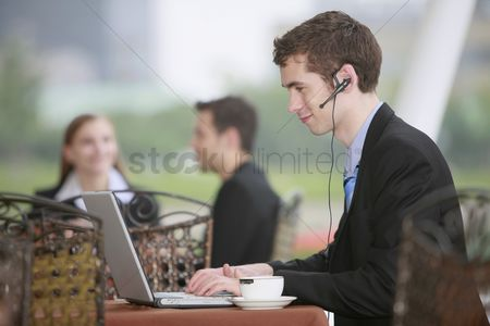 Eastern european ethnicity : Businessman using laptop at outdoor cafe