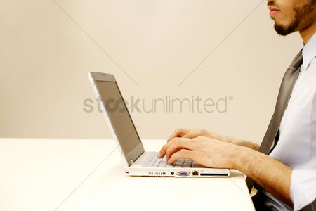 Mature : Businessman using laptop