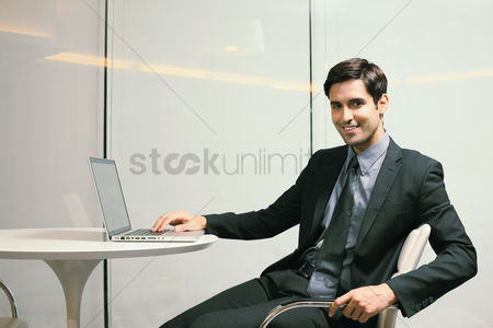 Business suit : Businessman using laptop
