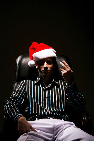 Respect : Businessman with christmas hat smoking cigarette