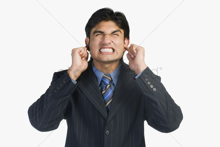Corporation : Businessman with his fingers in ears