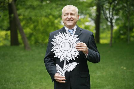 Cardboard cutout : Businessman with sunflower