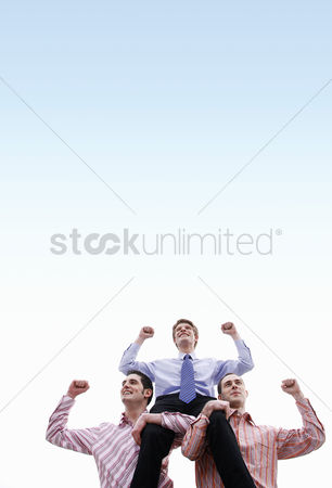 Celebrating : Businessmen celebrating their success