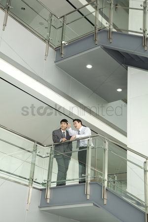 Advice : Businessmen discussing and pointing on stairway