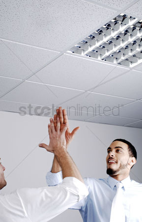 High ceiling : Businessmen giving high five