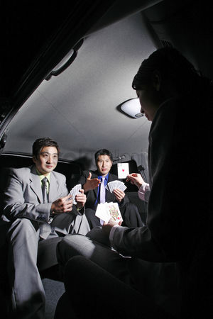 Spacious : Businessmen playing cards in the car