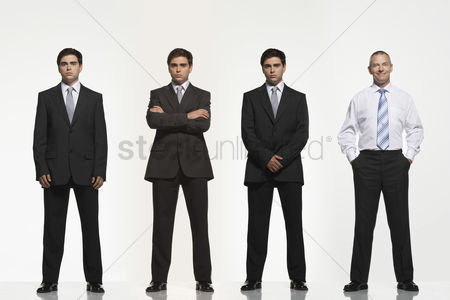 Pocket : Businessmen standing side by side arms crossed by side clasped in pockets digitally enhanced