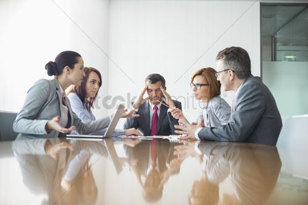 Businesswomen : Businesspeople arguing in meeting