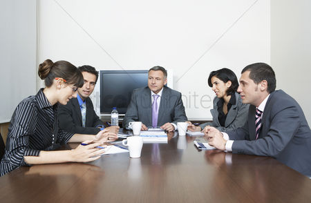 Leadership : Businesspeople having meeting in office