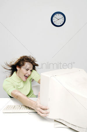Amazed : Businesswoman being blown away by a computer desktop