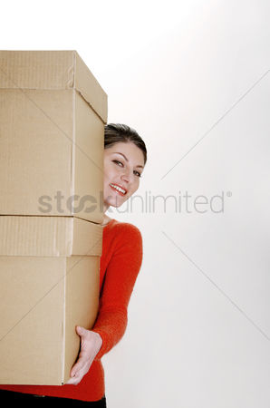 Strong : Businesswoman carrying two big boxes