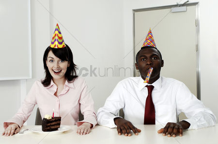 Celebrating : Businesswoman celebrating her birthday with a male colleague