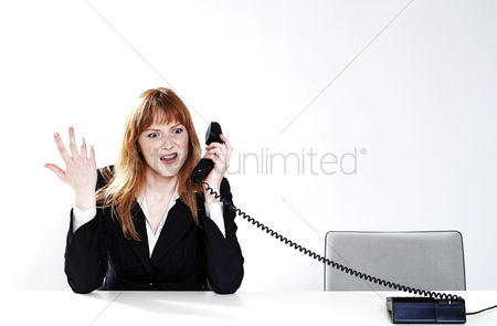 Mad : Businesswoman feeling irritated with a phone conversation