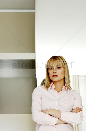 Composed : Businesswoman folding her arms while looking at the camera