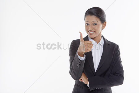 Malaysian indian : Businesswoman giving thumbs up