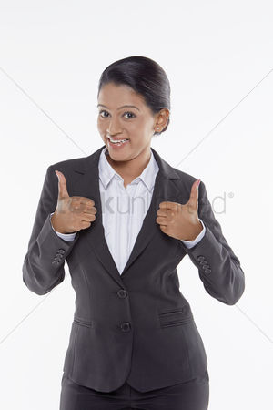 Malaysian indian : Businesswoman giving two thumbs up