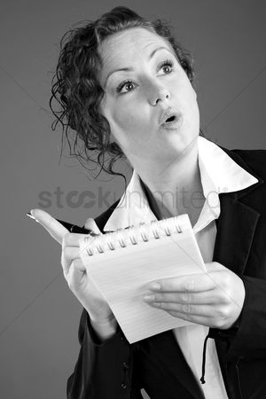 Notepad : Businesswoman holding a pen and a notepad