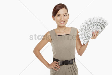 Asian : Businesswoman holding a pile of cash