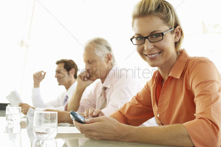 Smiling : Businesswoman in meeting