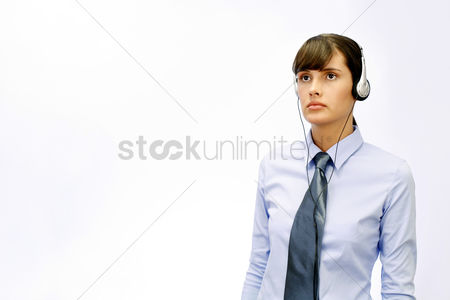 Satisfying : Businesswoman listening to music on the headphones