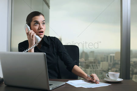 Accessibility : Businesswoman looking shocked while talking on the phone