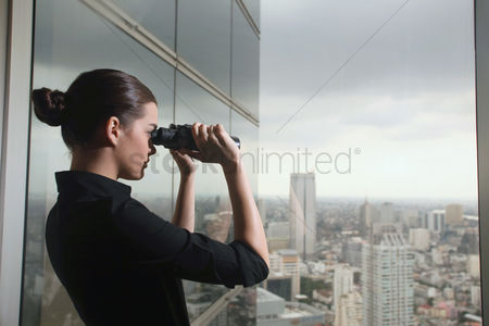 Business : Businesswoman looking through binoculars