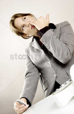 Ignorance : Businesswoman picking her nose