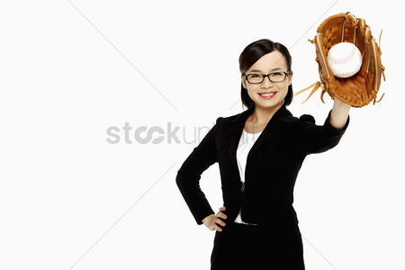 Pitch : Businesswoman playing baseball