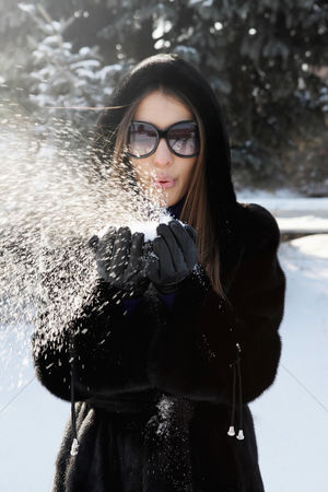Cold temperature : Businesswoman playing with snow