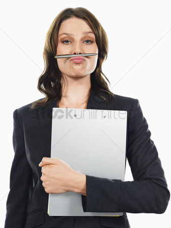 Funny : Businesswoman pulling funny face with pen