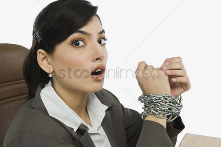 Forbidden : Businesswoman s hands tied up with a chain