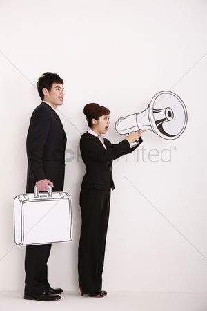 Cardboard cutout : Businesswoman shouting into megaphone  businessman holding briefcase standing behind her